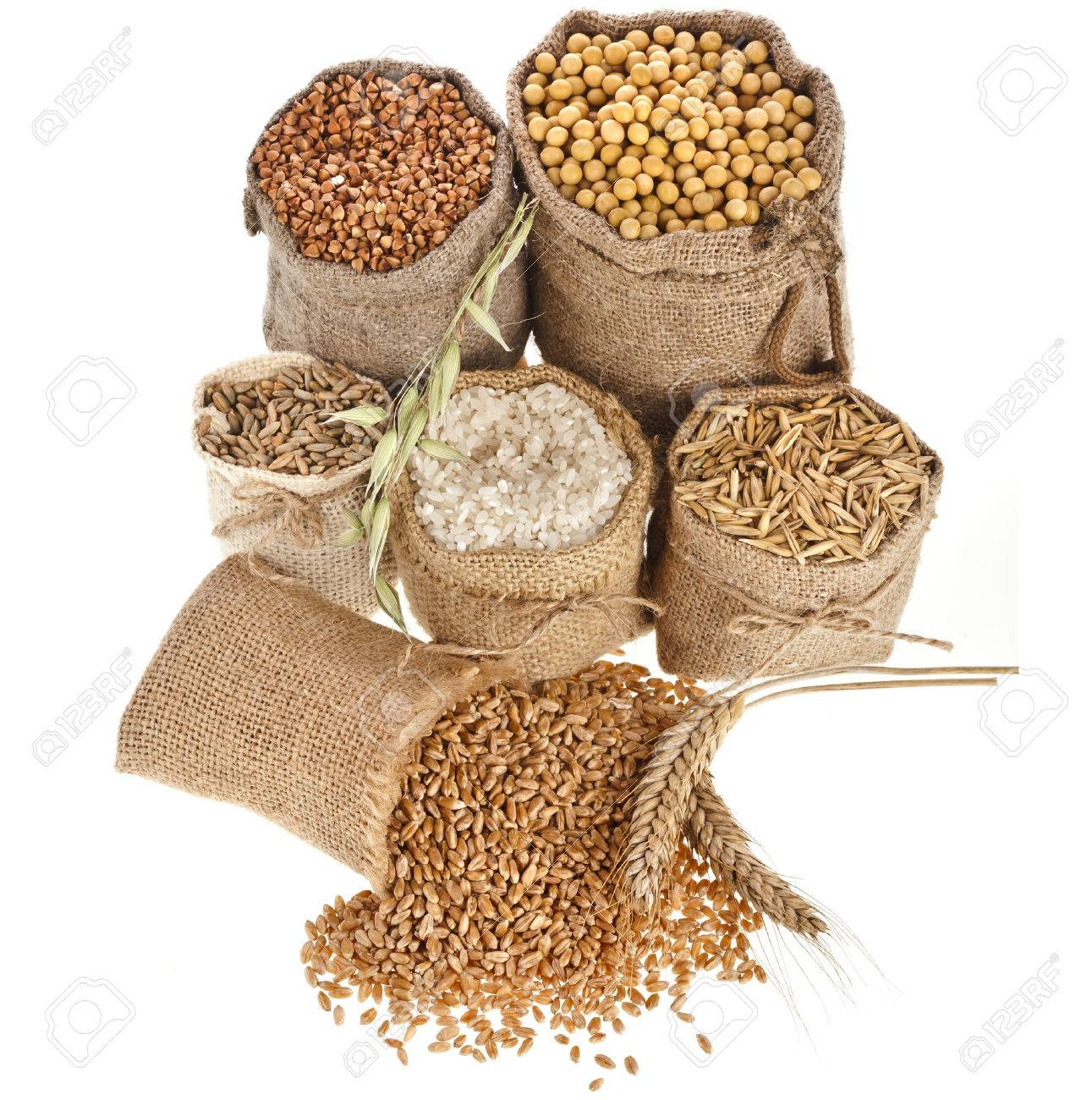 groats seed meal and grains in bags close up isolated on a white background - 29436417