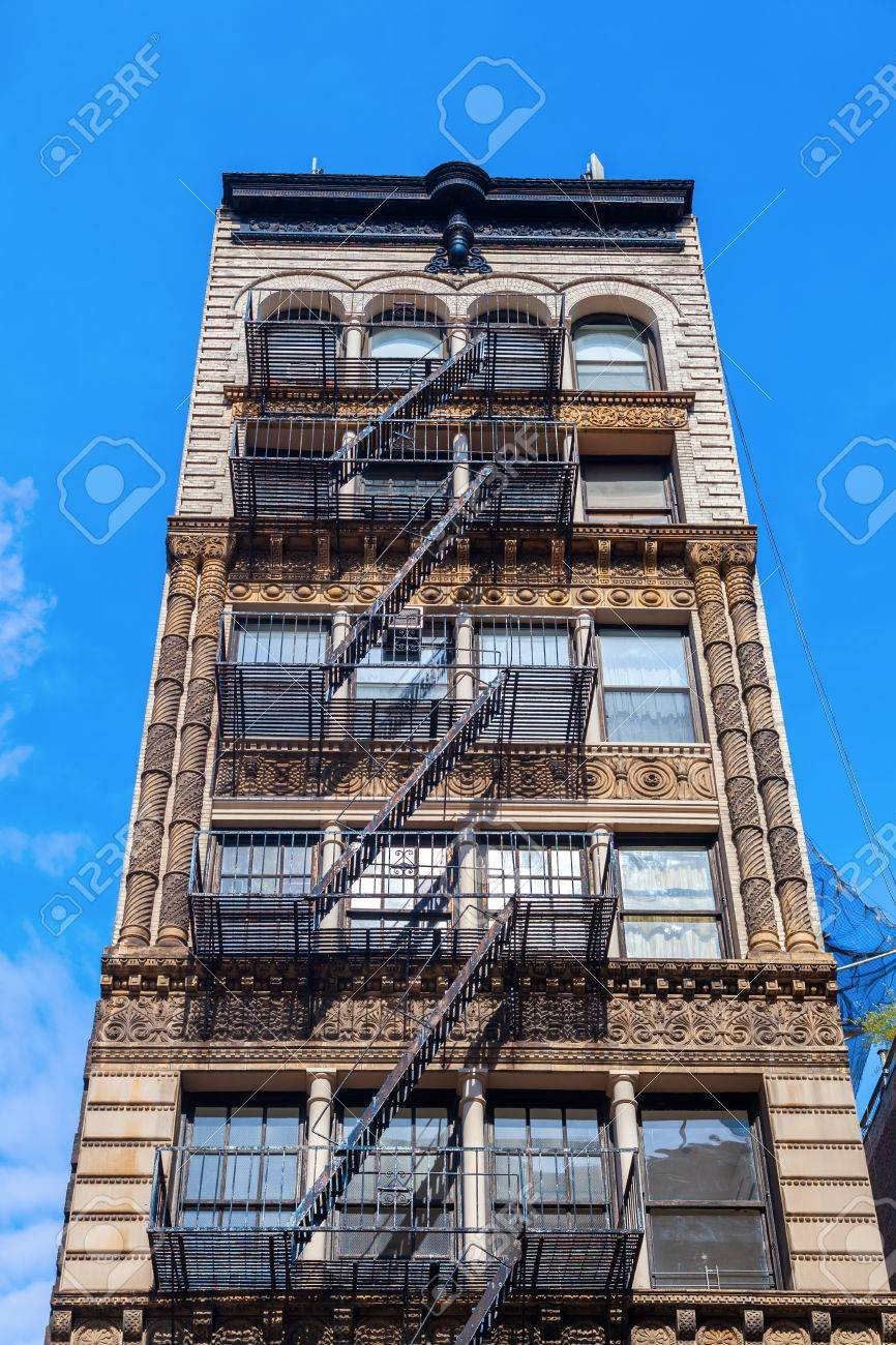 Building With Fire Escape Stairs In Manhattan, NYC Stock Photo   51999004