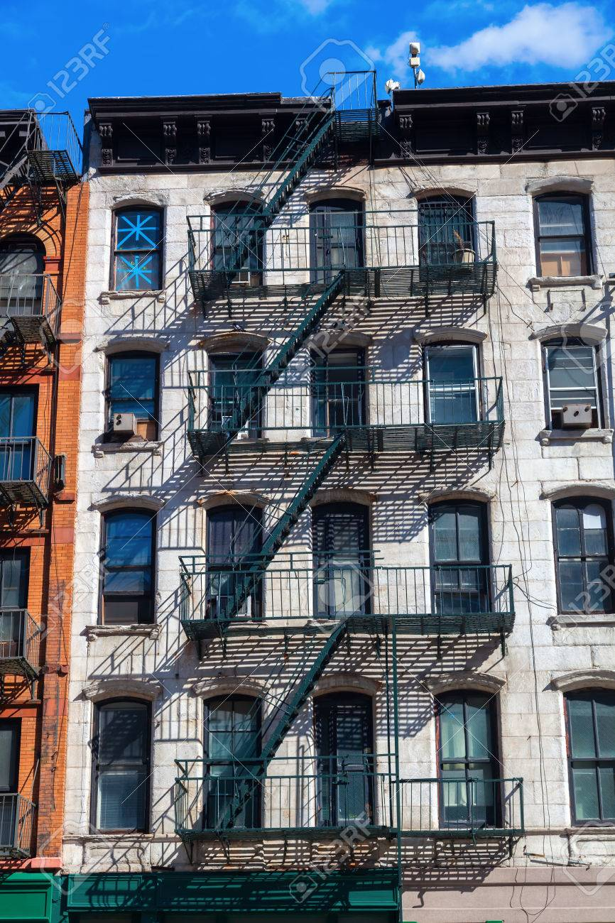 Building With Typical Fire Escape Stairs In Manhattan, NYC Stock Photo    51755036
