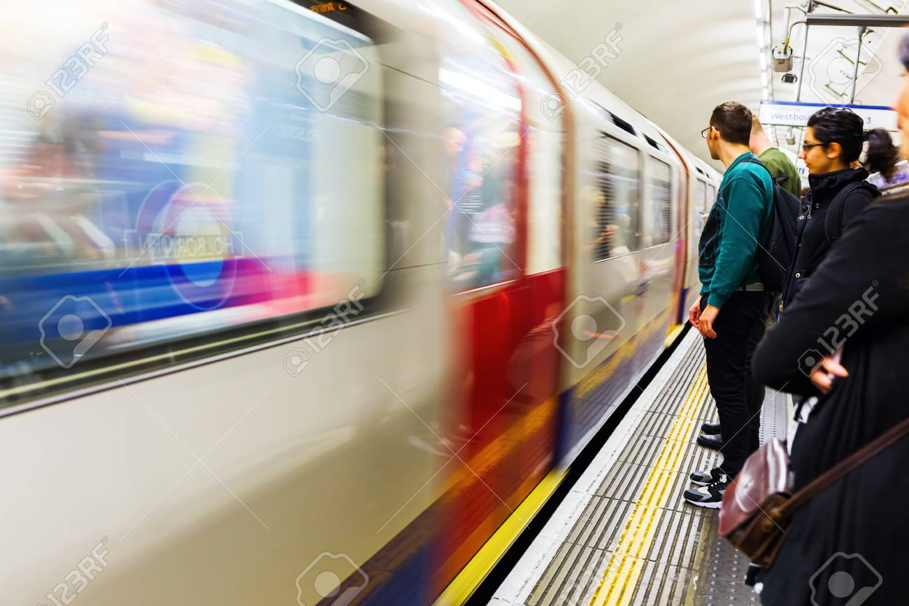 London, UK - June 19, 2016: platform of an underground station with unidentified people in London. The London Underground is the oldest underground of the world. - 59392782