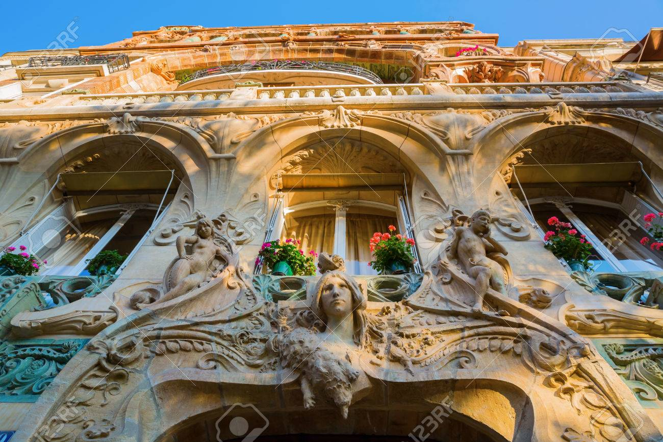facade of an art nouveau building in paris france stock photo