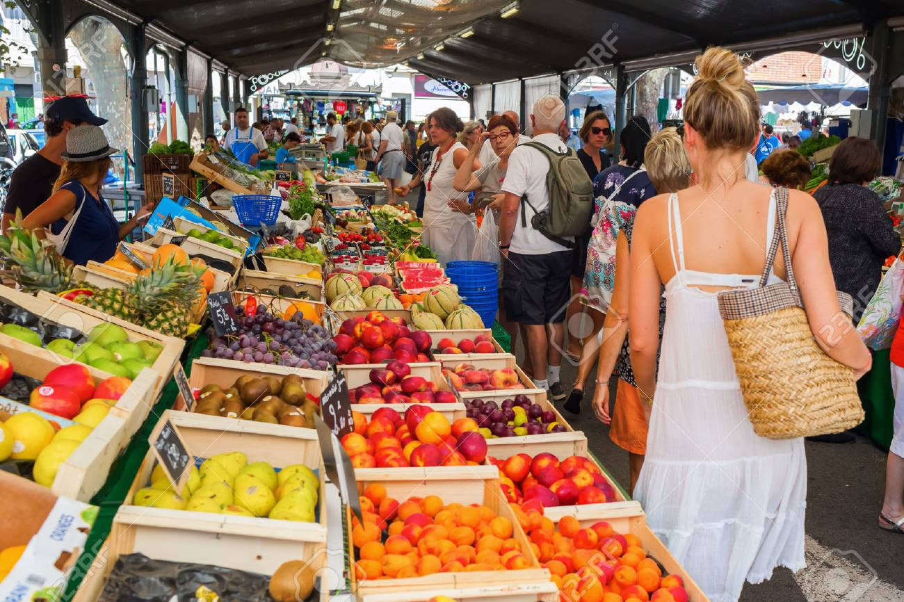 Cannes, France - August 05, 2016: Provencal market in Cannes with unidentified people. Cannes is well known for its association with the rich and famous, and the Cannes Film Festival - 68266667