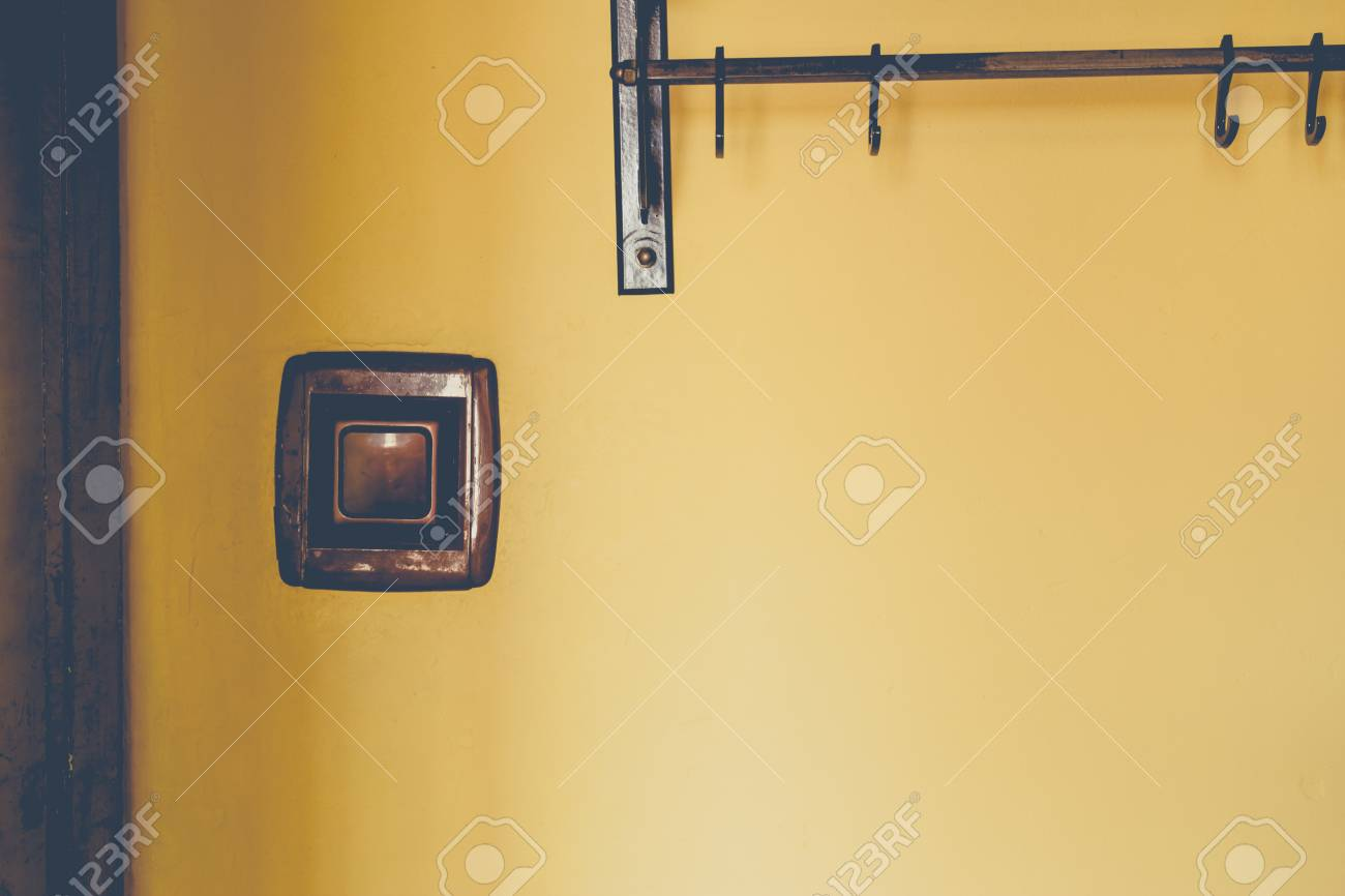 Background made from a light switch and a home hanger on yellow.. on manufactured housing module home, yellow mobile stars, mystic yellow paint color home, burgundy with yellow trim home,