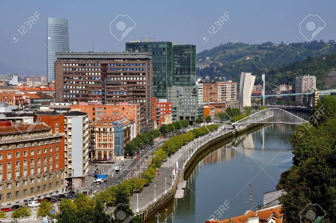 Aerial view of Bilbao city downtown with a Nevion River, Zubizuri Bridge and promenade Stock Photo - 13847798