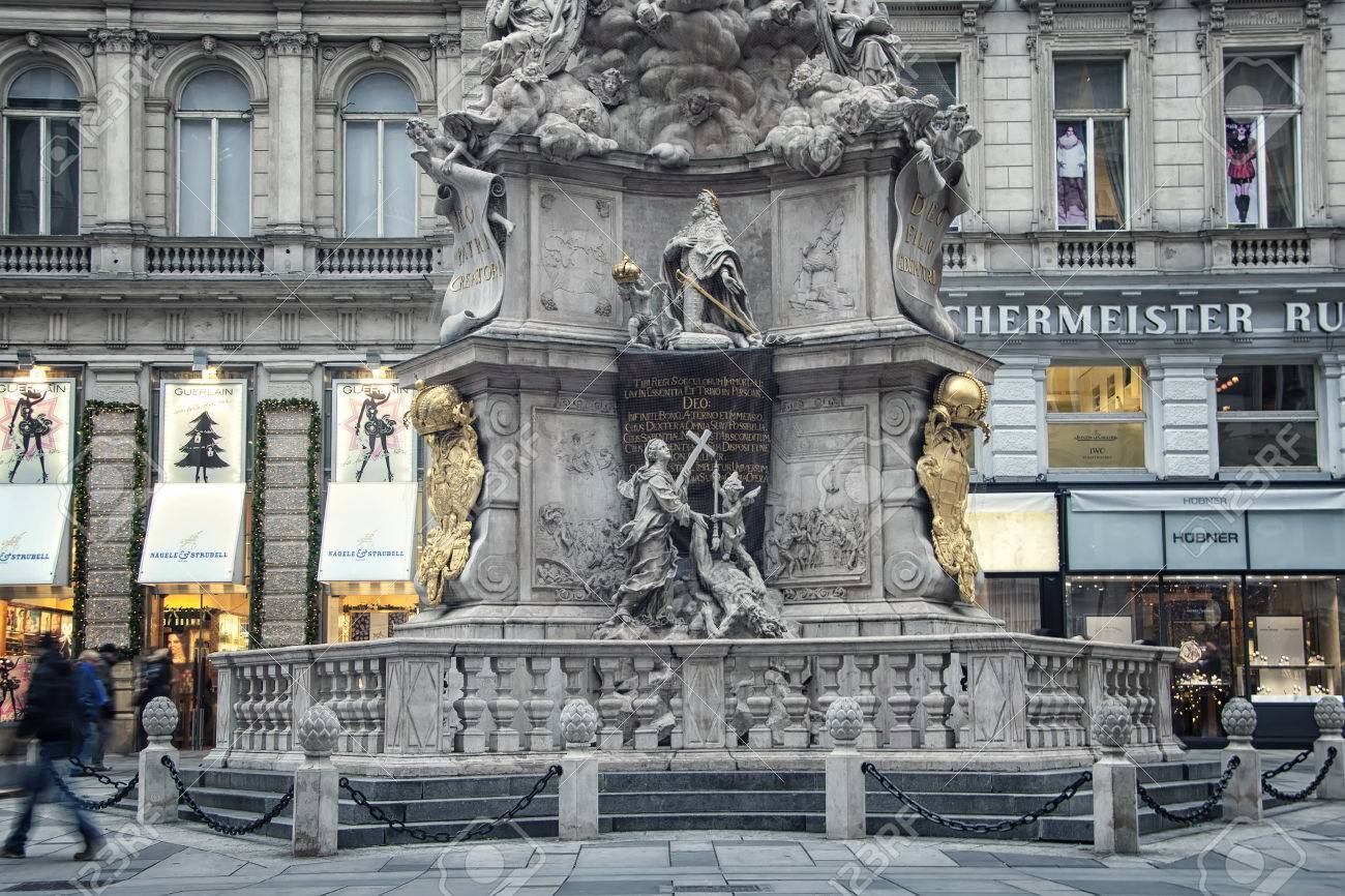 Stock Photo   VIENNA, AUSTRIA   NOVEMBER 28, 2013: City Center Graben  Street With Shops And Christmas Decorations. Pestsaule Sculpture Showing  The Holy ...
