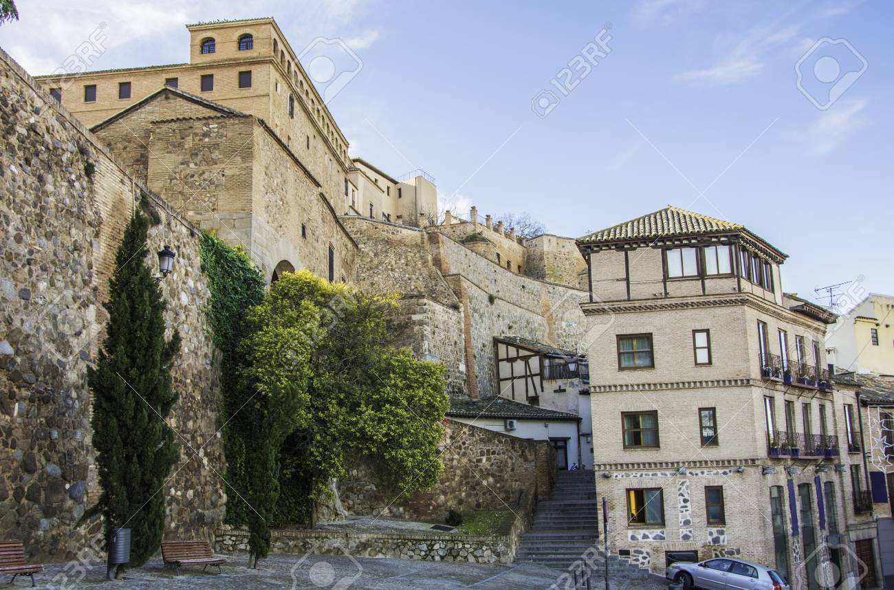 medieval style walls and buildings in the city of toledo facing
