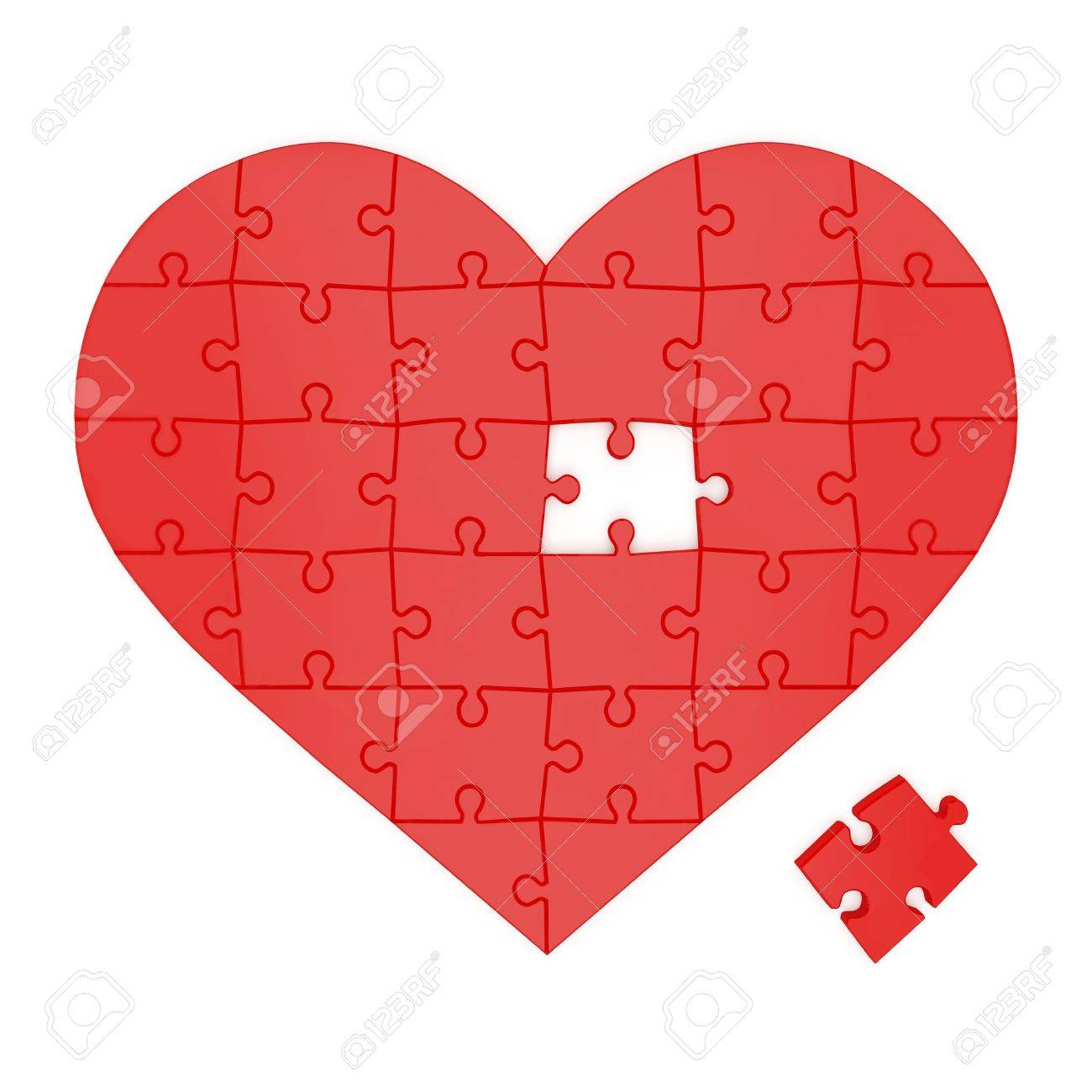 Red heart made of puzzles on a white background Stock Photo - 11321563