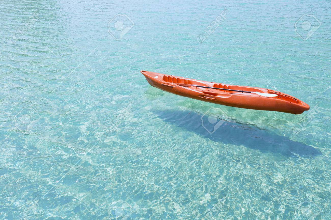 Kayak floating on the clear sea water background Stock Photo - 48417967