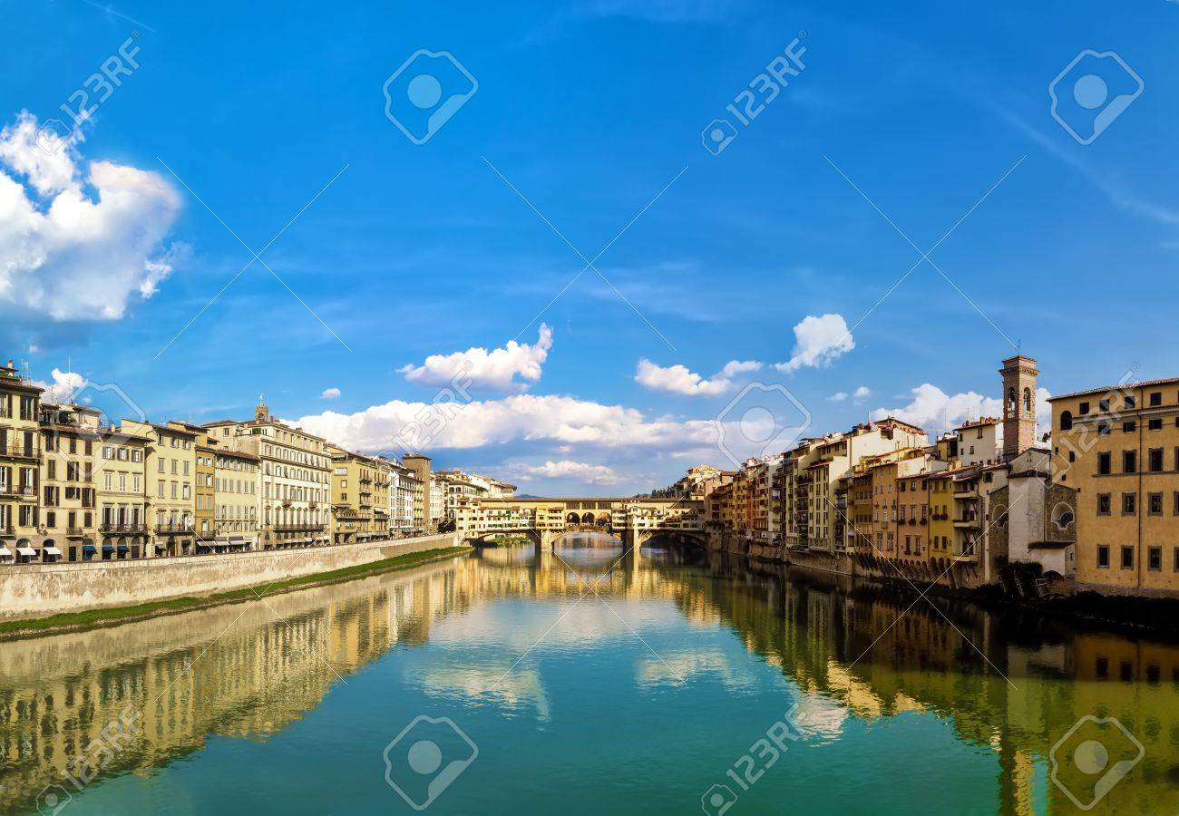 Florence, With The Blue Sky Reflected In The River Arno, Creates ...