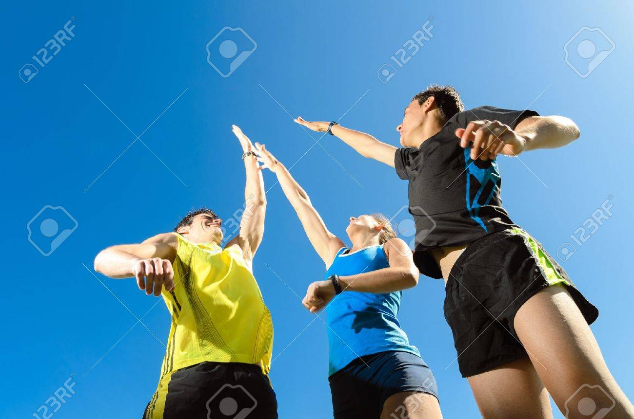 Young team with two men and woman, fiving and jumping for celebrate victory and achievements - 14274456