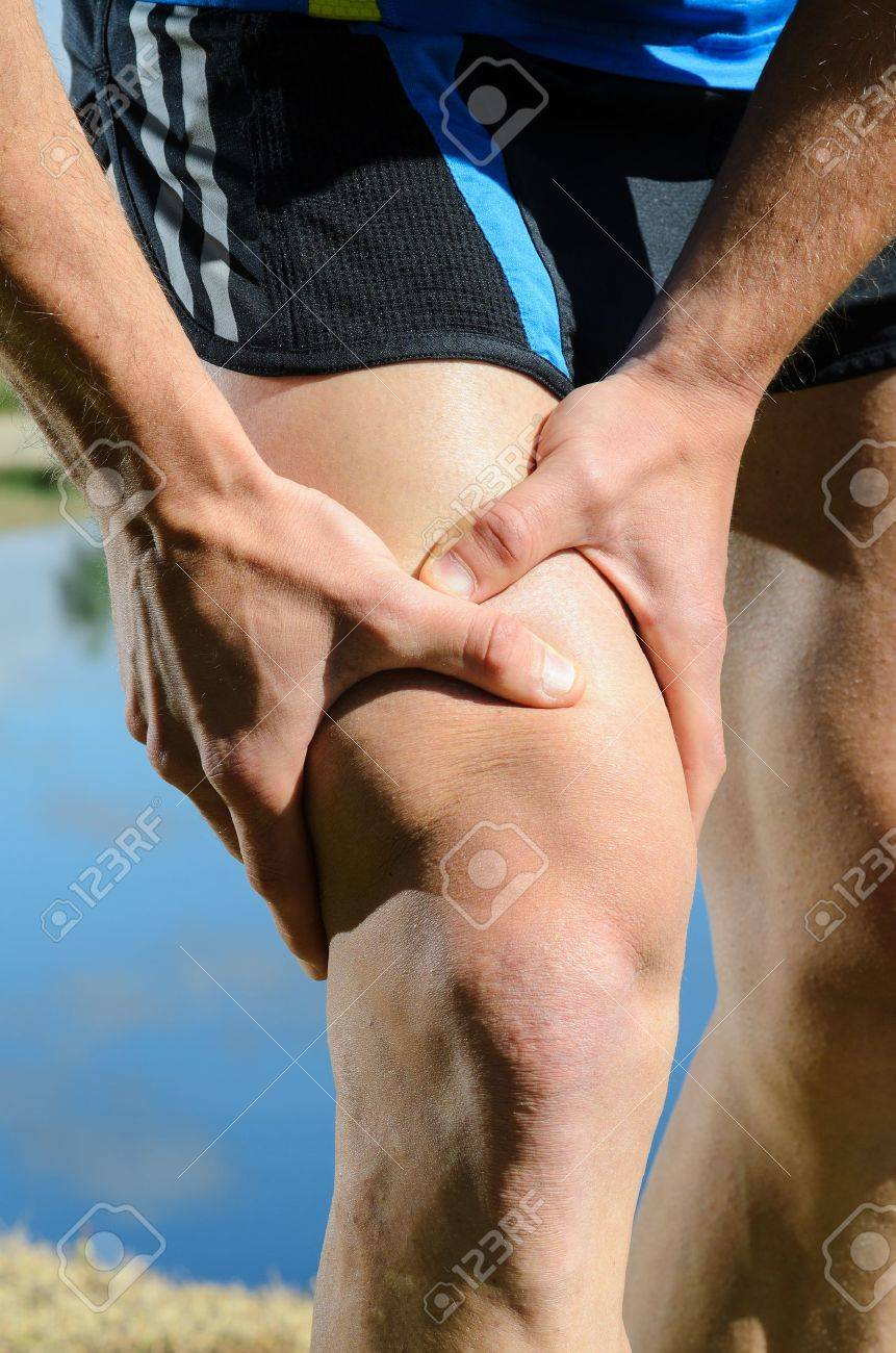 Runner feels muscle pain and grabs the leg. Stock Photo - 14301114