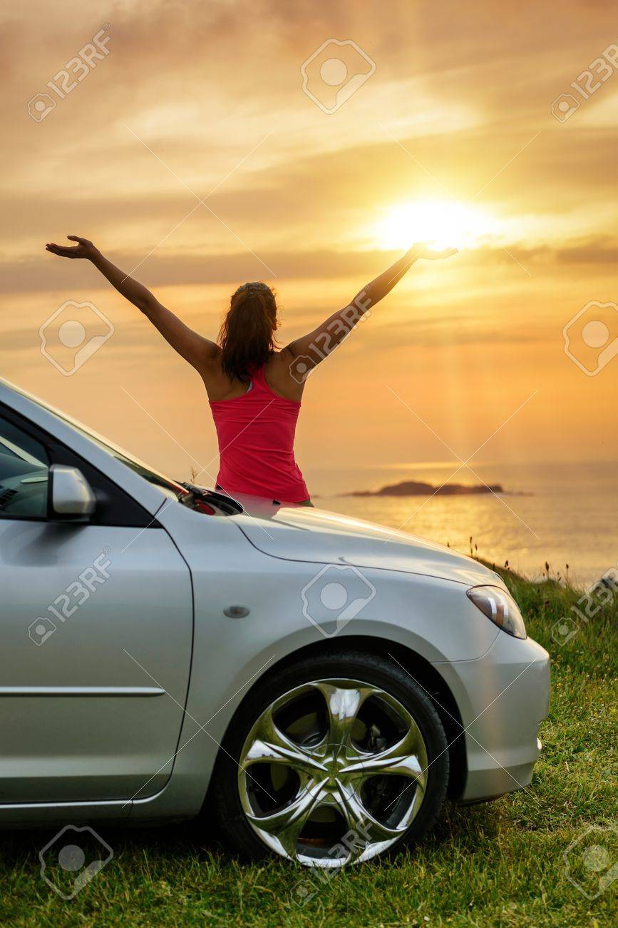 free woman on car travel looking summer sunset and ocean female