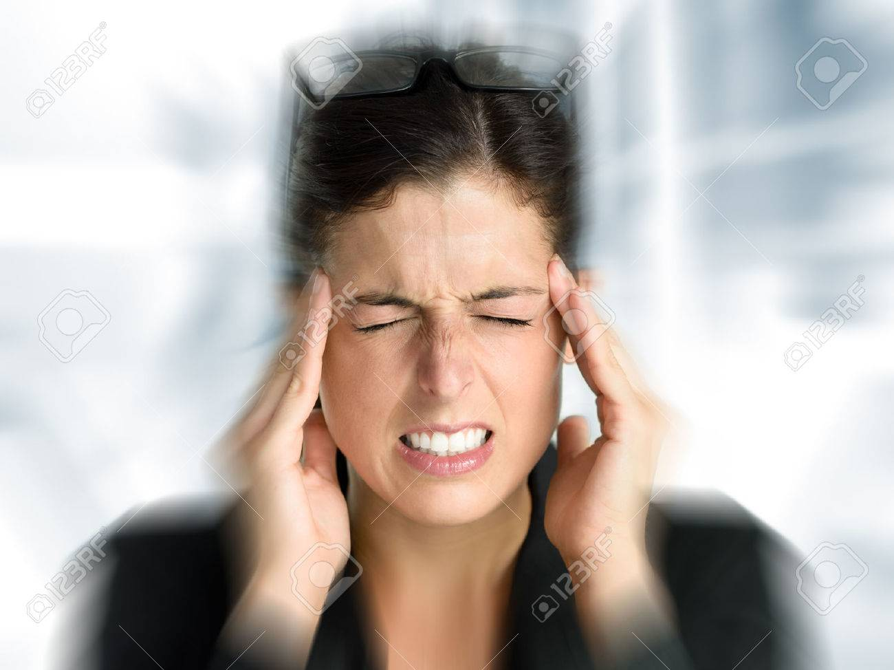 Businesswoman with intense stress and painful headache Woman in job problems - 23339277