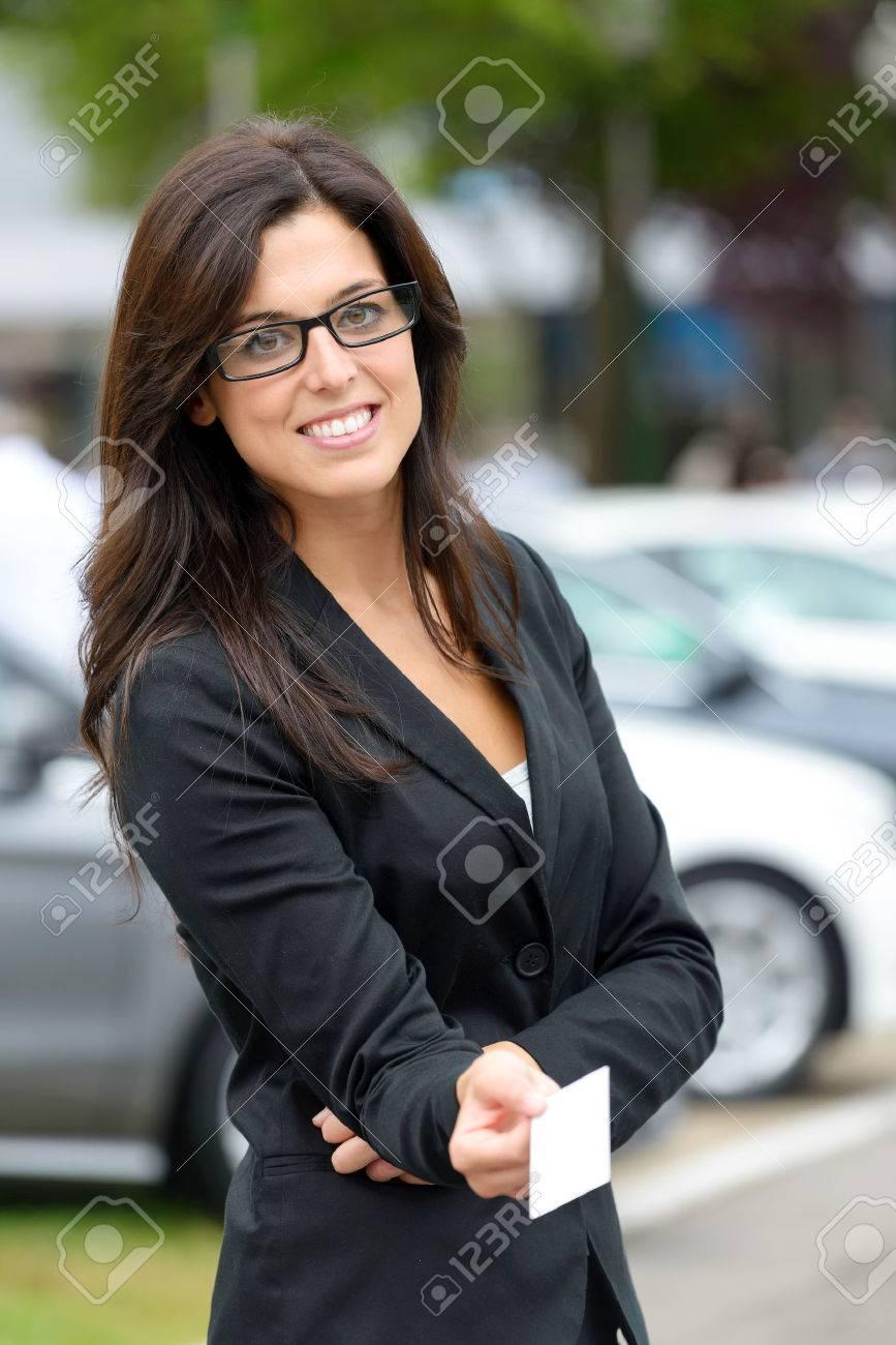 Successful Female Car Sales Representative Giving Blank Business ...