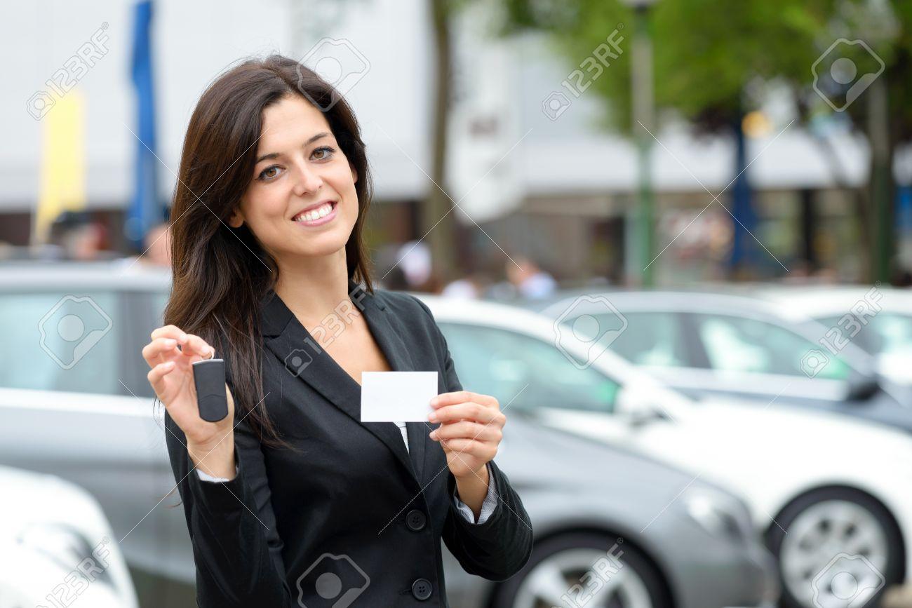Successful Female Luxury Car Sales Representative Showing Car ...