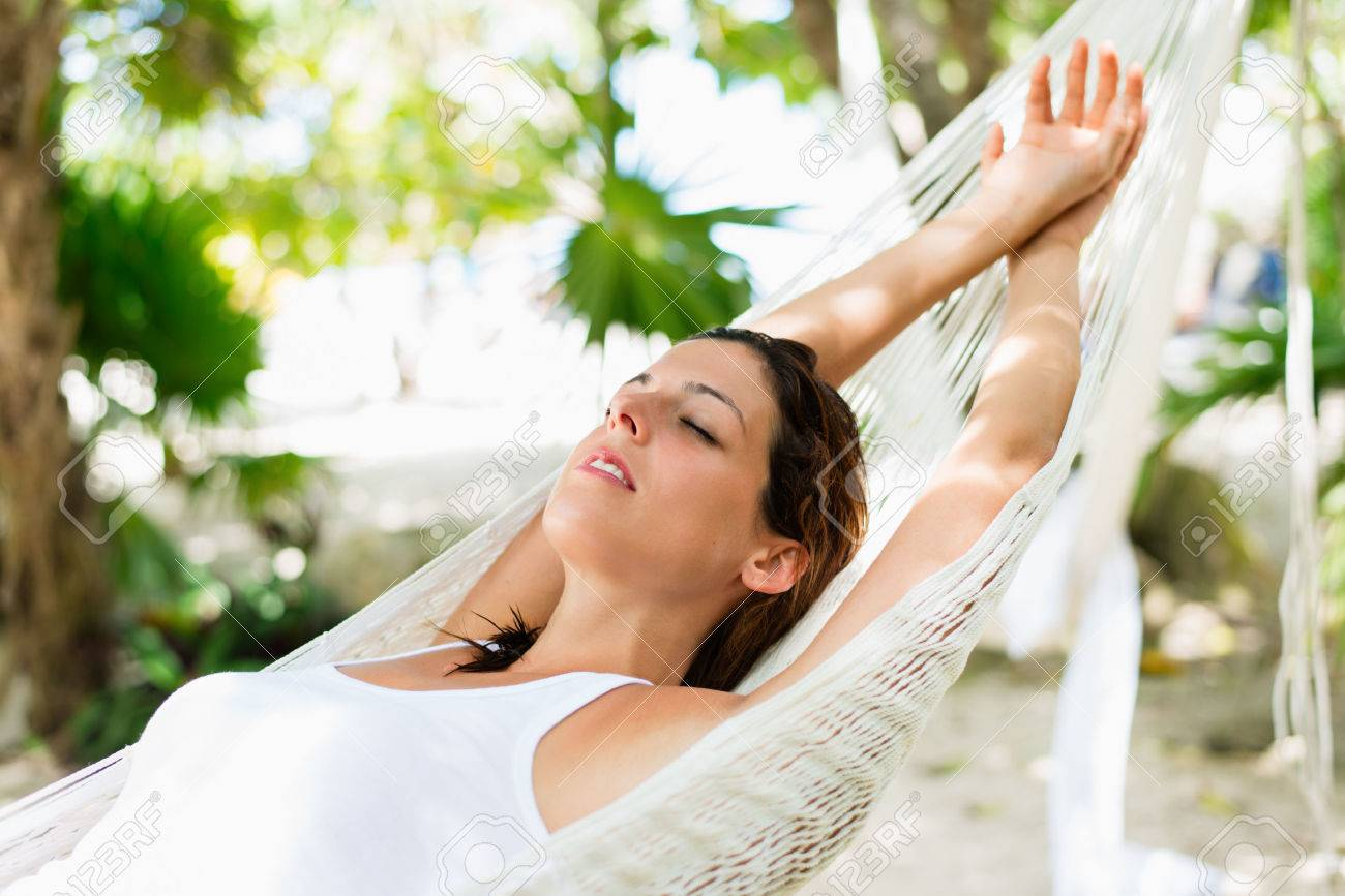 Relaxed woman napping on hammock. Relaxing tranquility on caribbean vacation. - 55458706