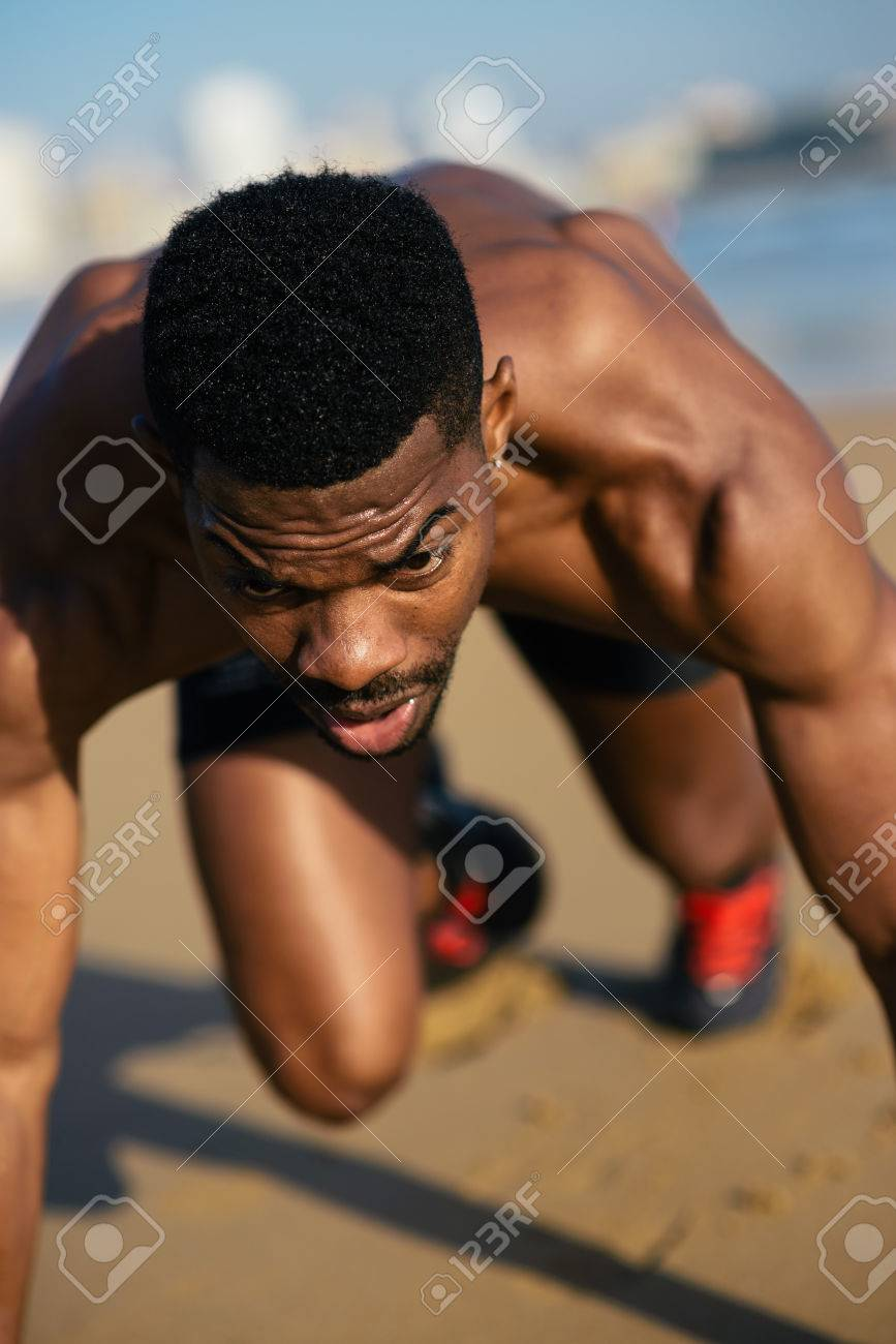 Running and training motivation  Black runner on beach leg power