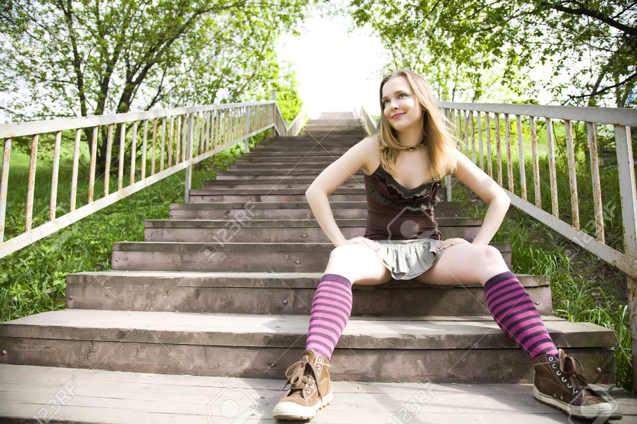 Young Lady Sitting On Wooden Stairs Stock Photo - 3019254