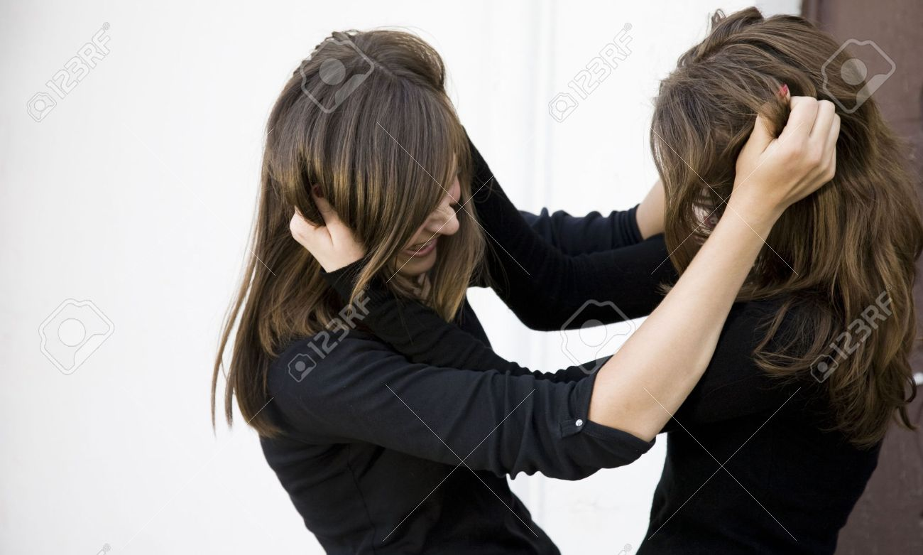Conflict. Two Teenager Girls Fighting Outdoors. Stock Photo - 3331154