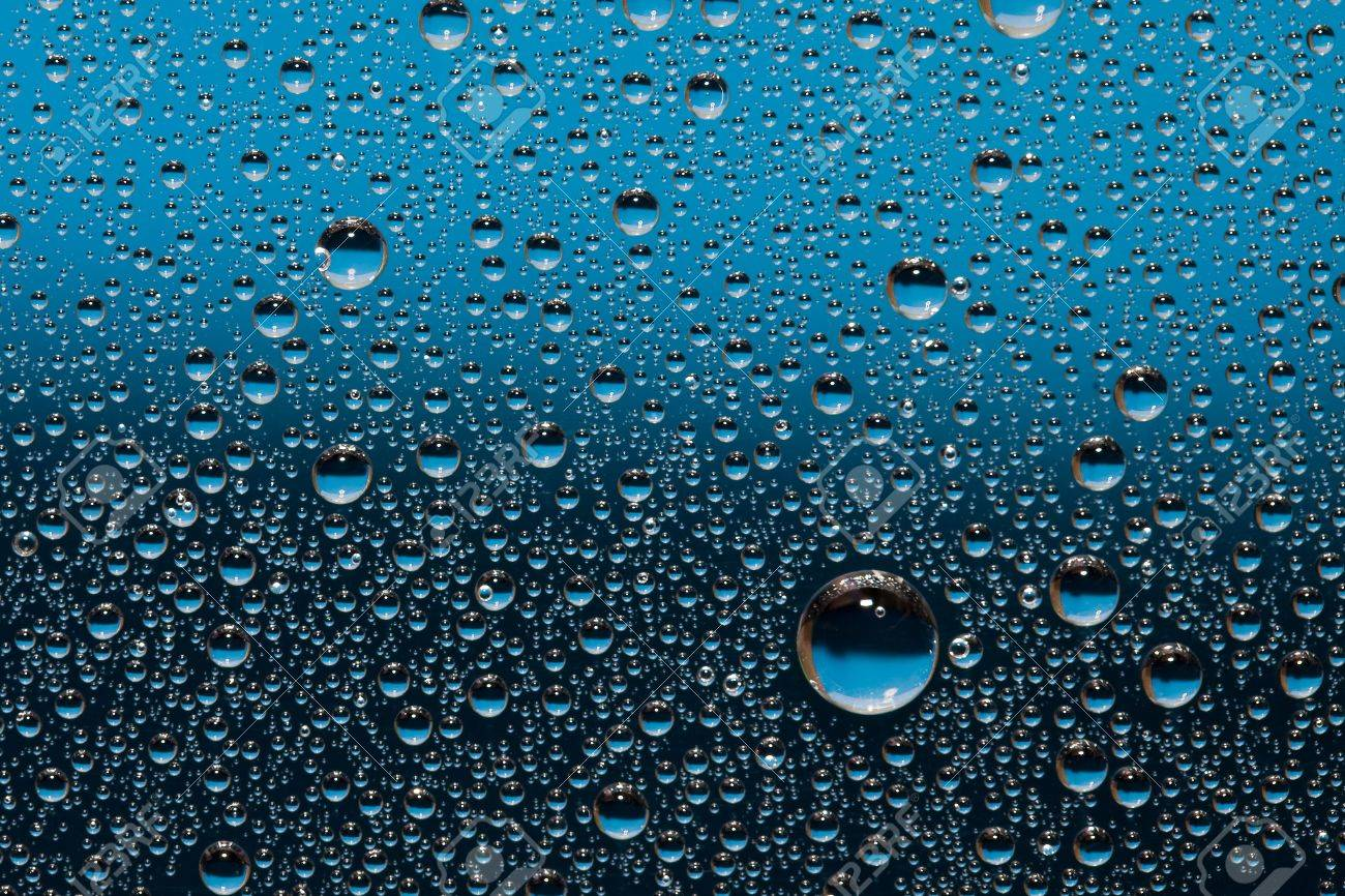 Blue water drops on the glass. Nature collection. Stock Photo - 6498465