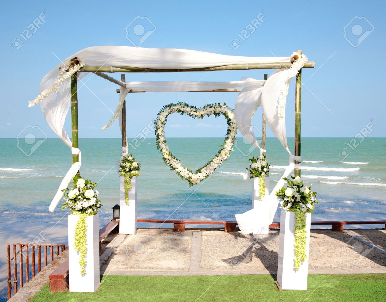Wedding arch with flowers decoration on the beach Stock Photo - 9181644