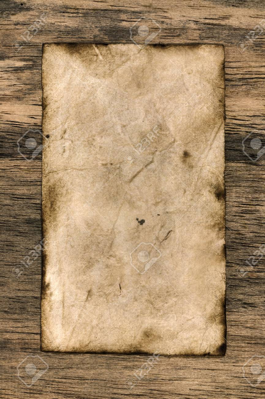 Grunge yellow paper on wooden background Stock Photo - 9319675