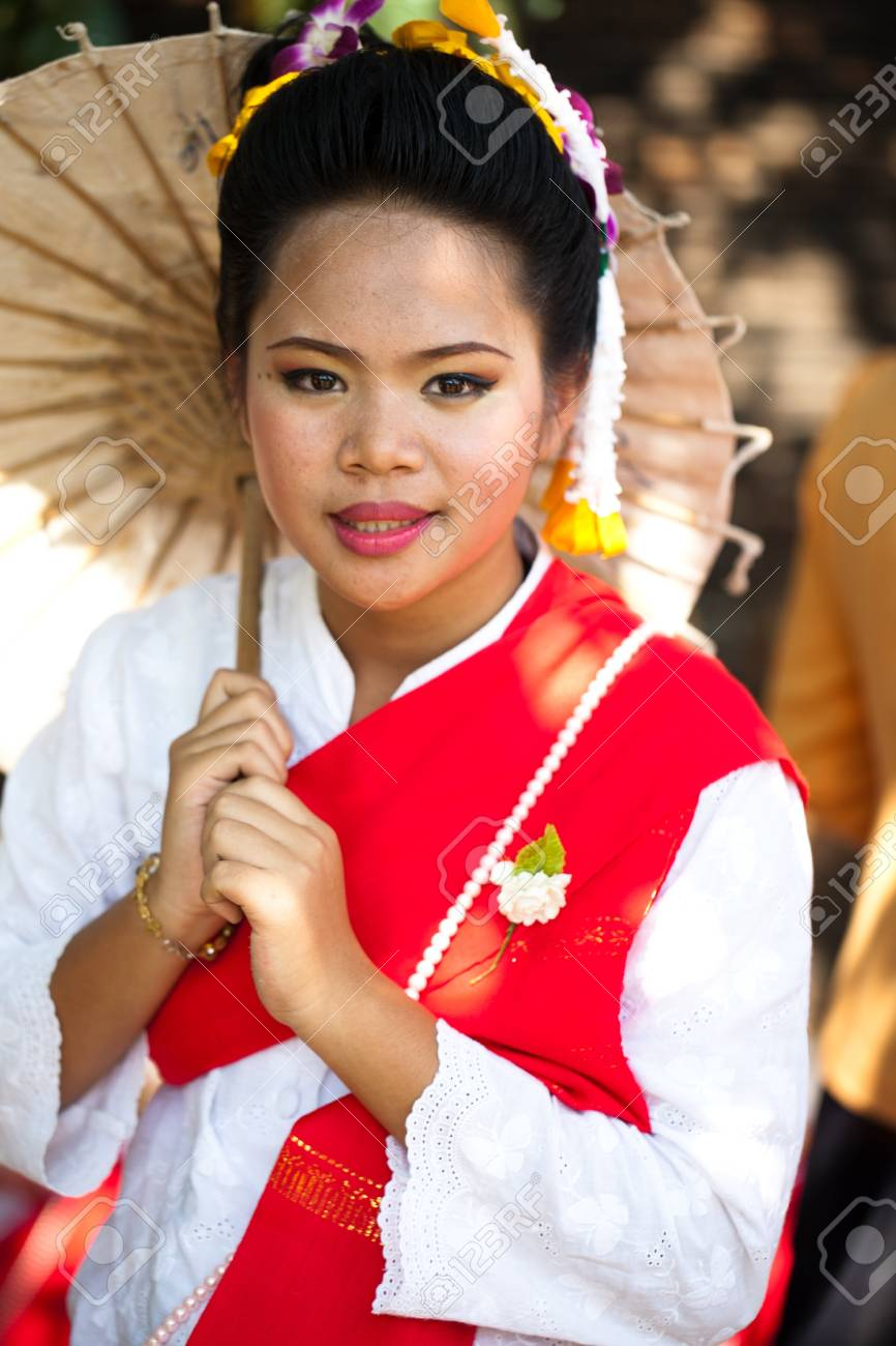 CHIANG MAI, THAILAND - FEBRUARY 4: Traditionally dressed smiling woman on Chiang Mai 36th Flower Festival on February 4, 2012 in Chiang Mai, Thailand Stock Photo - 12386245