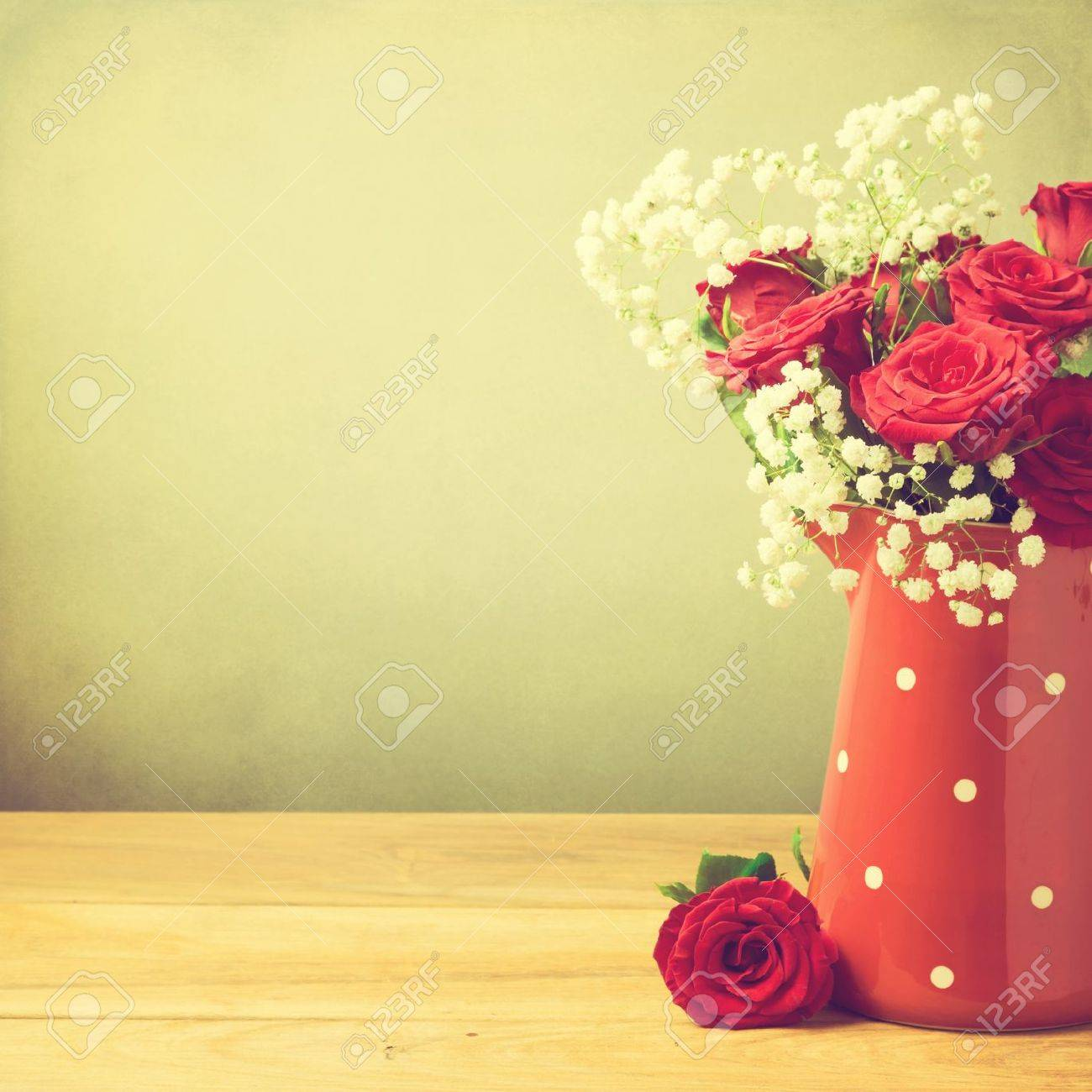 Rose flower bouquet in red polka dots jug with copy space - 21736218
