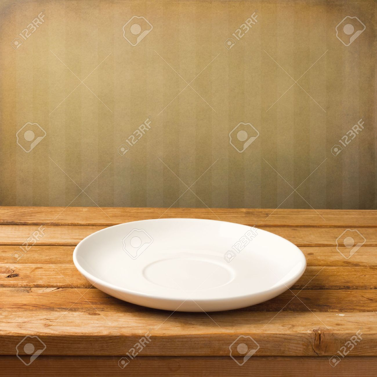 Empty White Plate On Wooden Table Over Grunge Striped Wallpaper Stock Photo Picture And Royalty Free Image Image 39478555