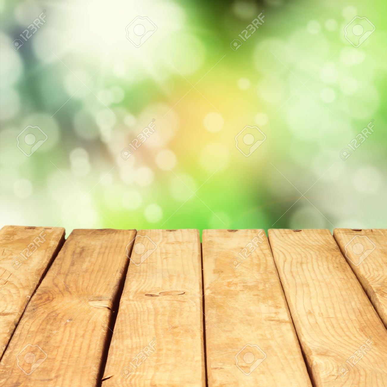 Picnic table background - Park Picnic Table Wooden Deck Table Over Beautiful Bokeh Background Stock Photo