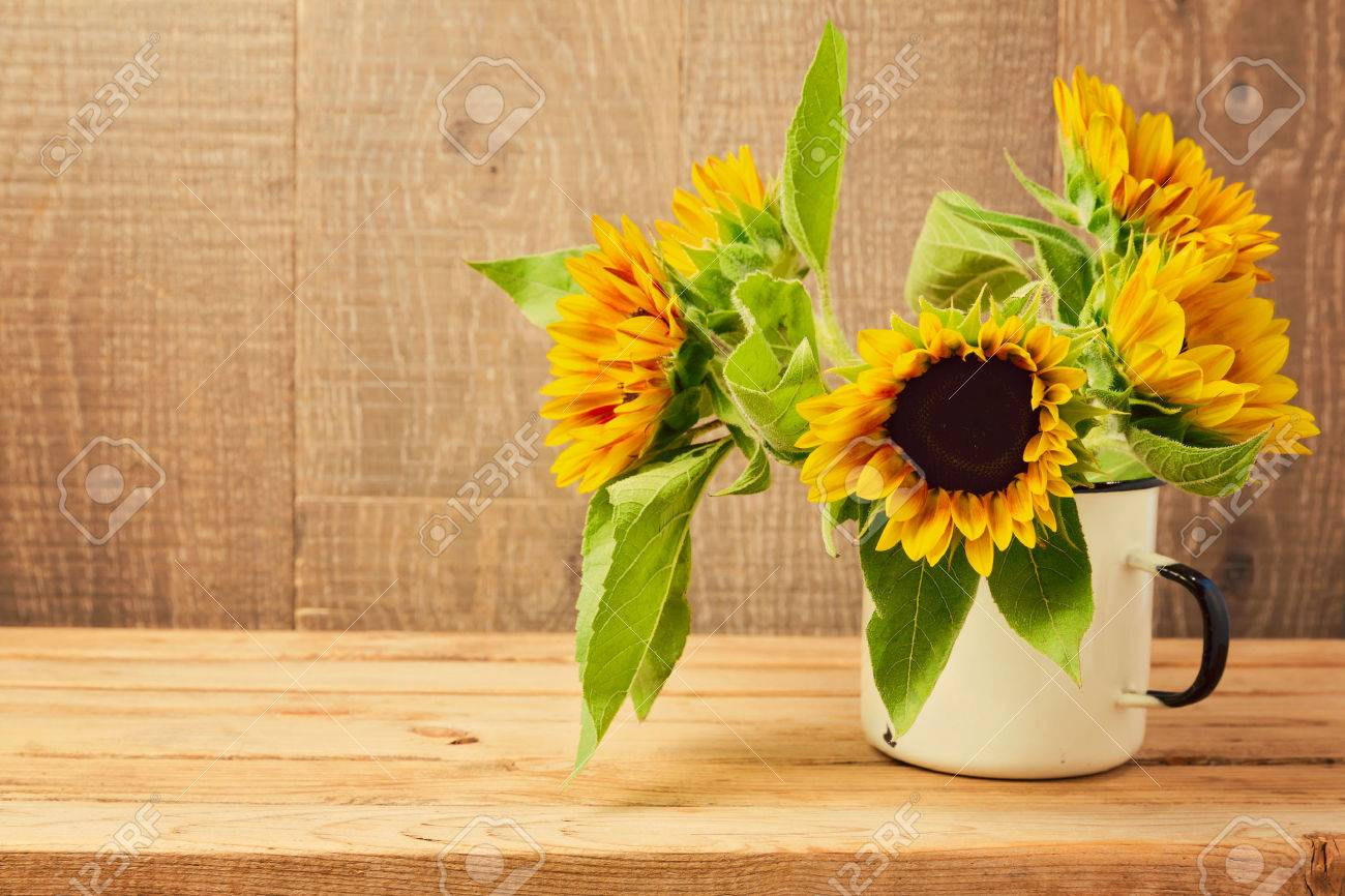 Sunflowers In Vintage Cup On Wooden Table Autumn Background Stock