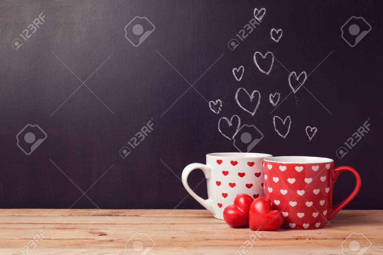 Valentine's day concept with hearts and cups over chalkboard background - 51016185
