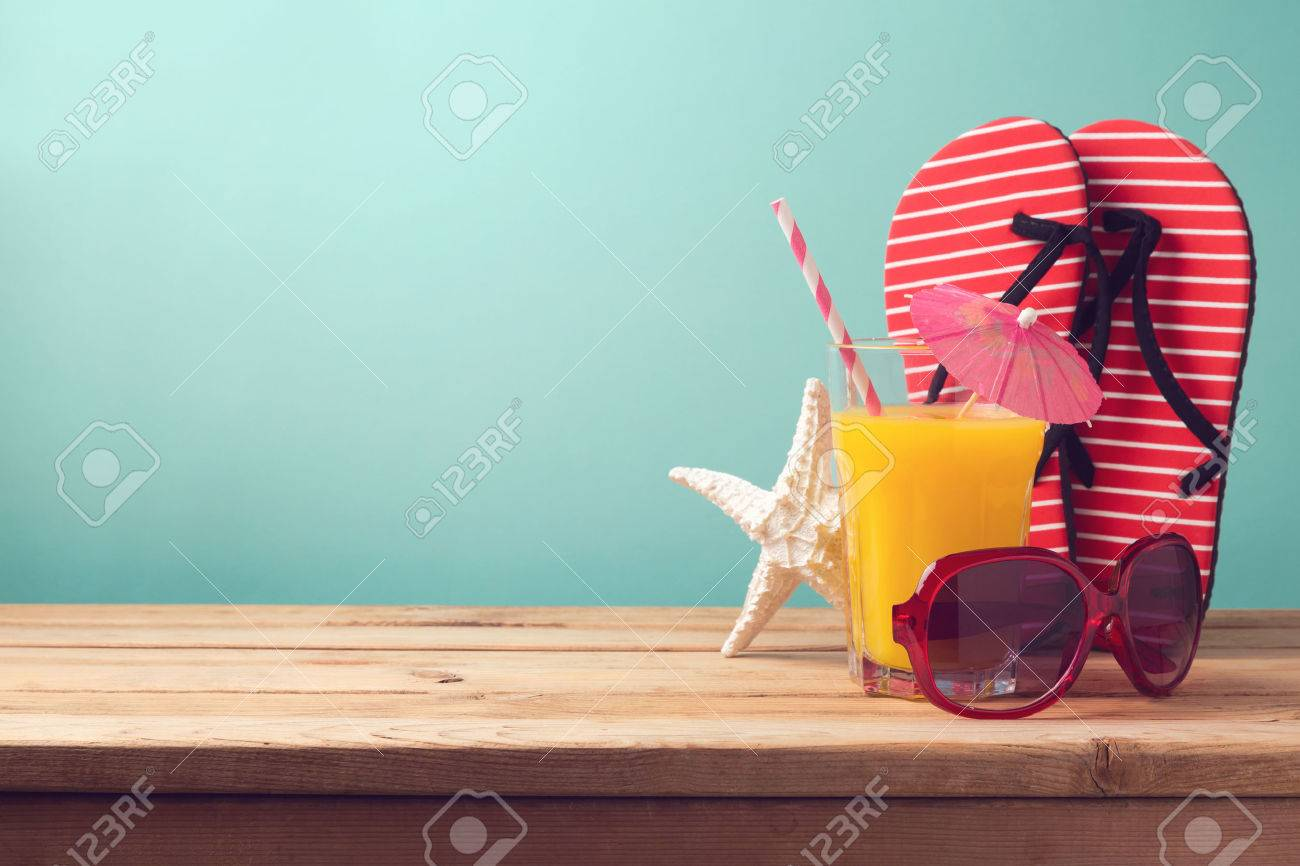 Summer holiday vacation background with orange juice and flip flops - 56211599