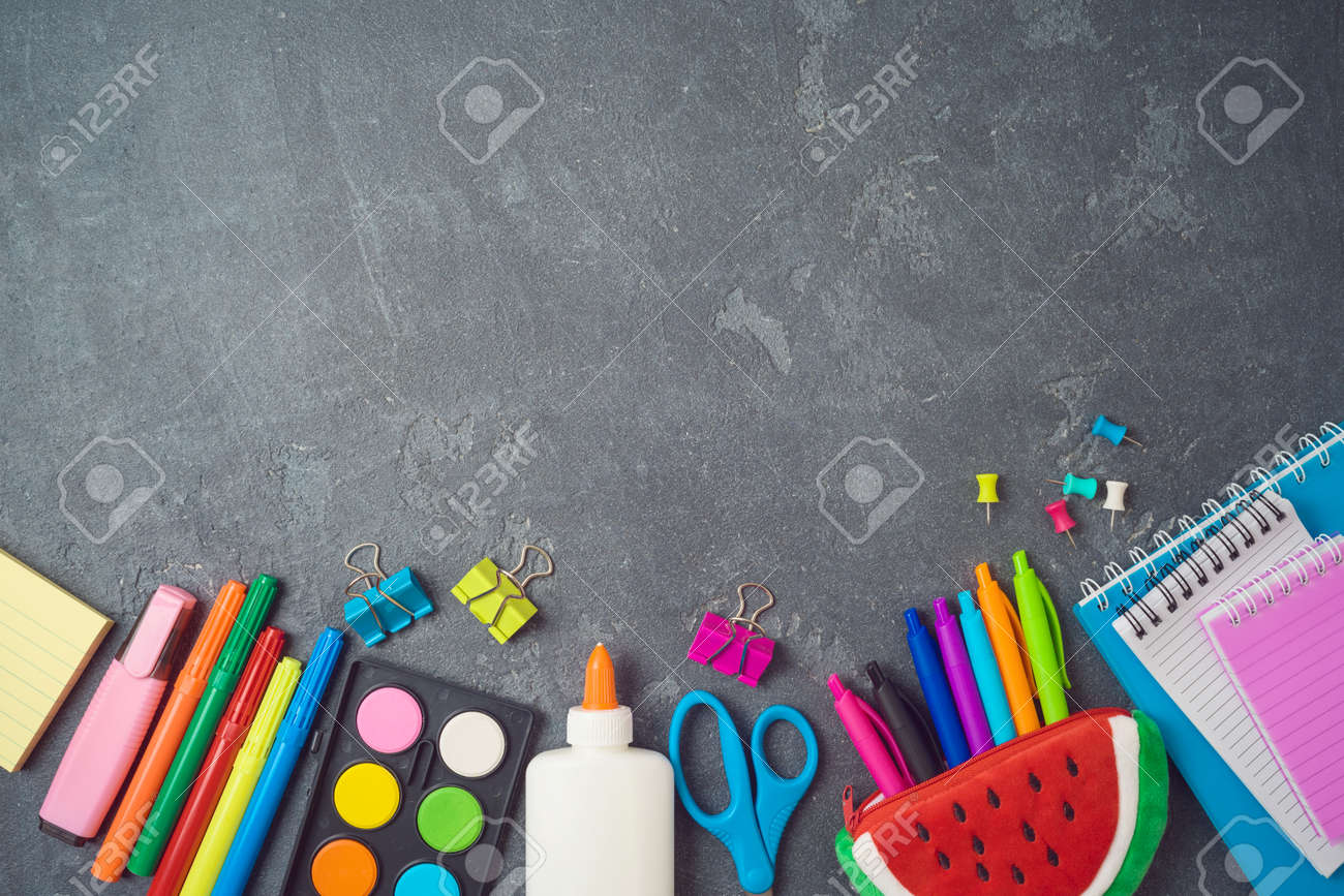 Back to school background with school supplies on blackboard. Top view from above - 125885083