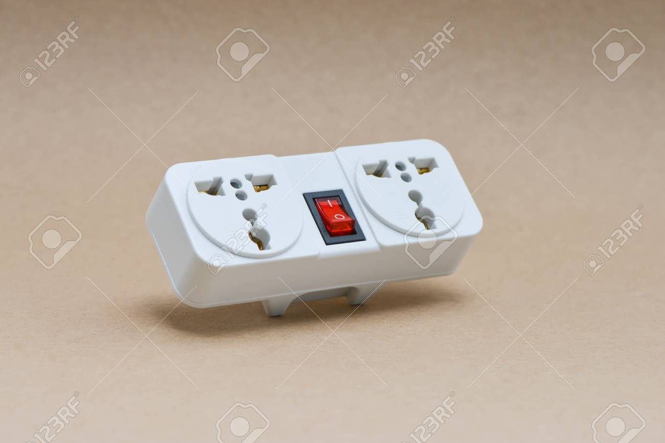 Electric Travel Outlet With Red Button Switch On The Brown ...