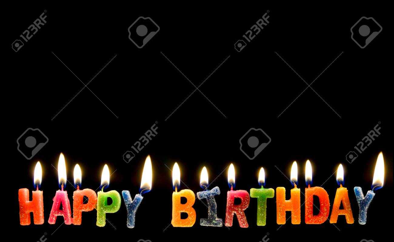 Colorful Of Happy Birthday Candle With Flame Lighting On The Black Screen Stock Photo