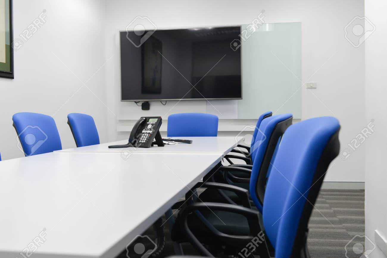 Led Tv Installed To The White Wall Of The Meeting Room With Black