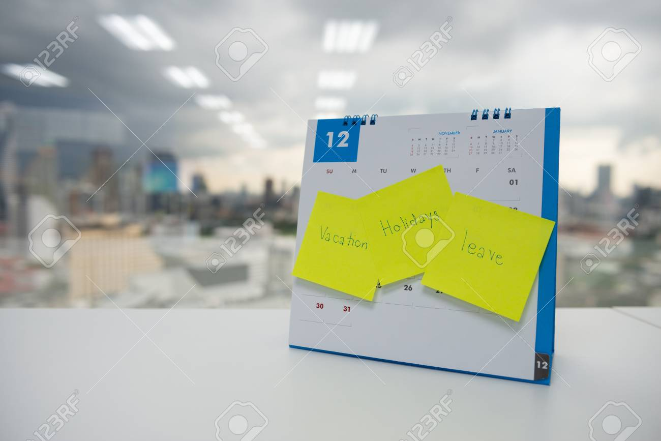 Vacation, holiday and leave on paper note stick on the calendar of December for year end holidays concept - 118982045