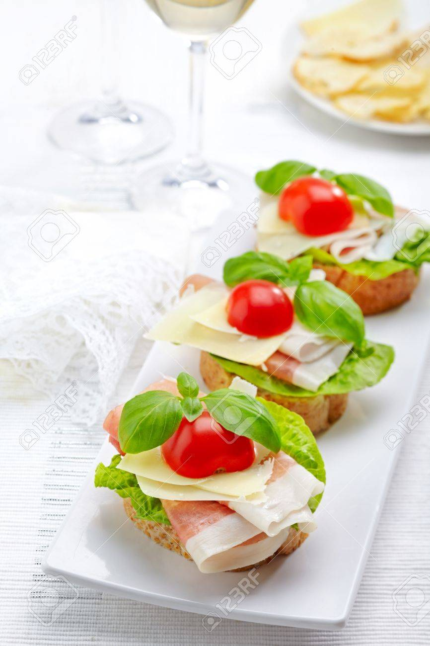 Sandwich with prosciutto, parmesan cheese and tomato Stock Photo - 16983806