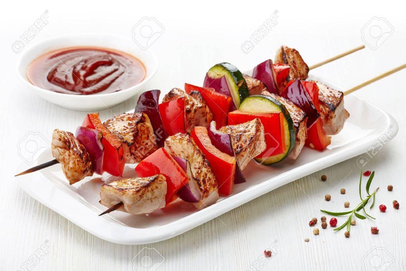 grilled pork fillet and vegetables on white background, pork barbecue Stock Photo - 20105846