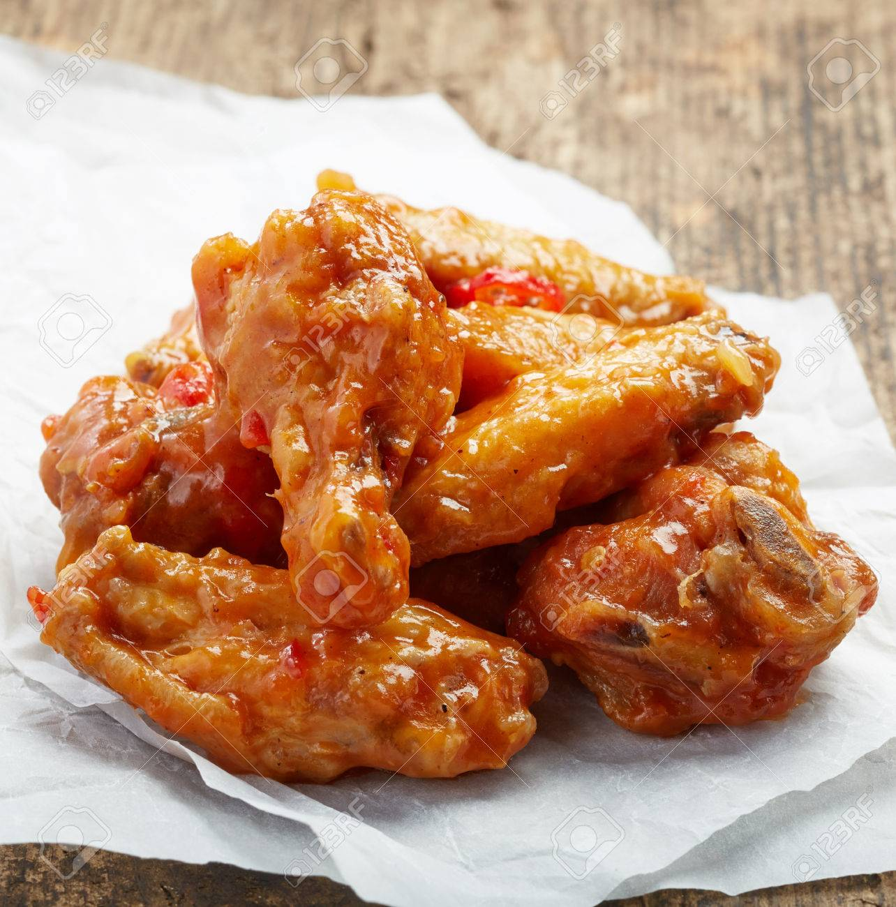 Fried Chicken Wings With Sweet Chili Sauce On White Paper Stock Photo Picture And Royalty Free Image Image 30468686