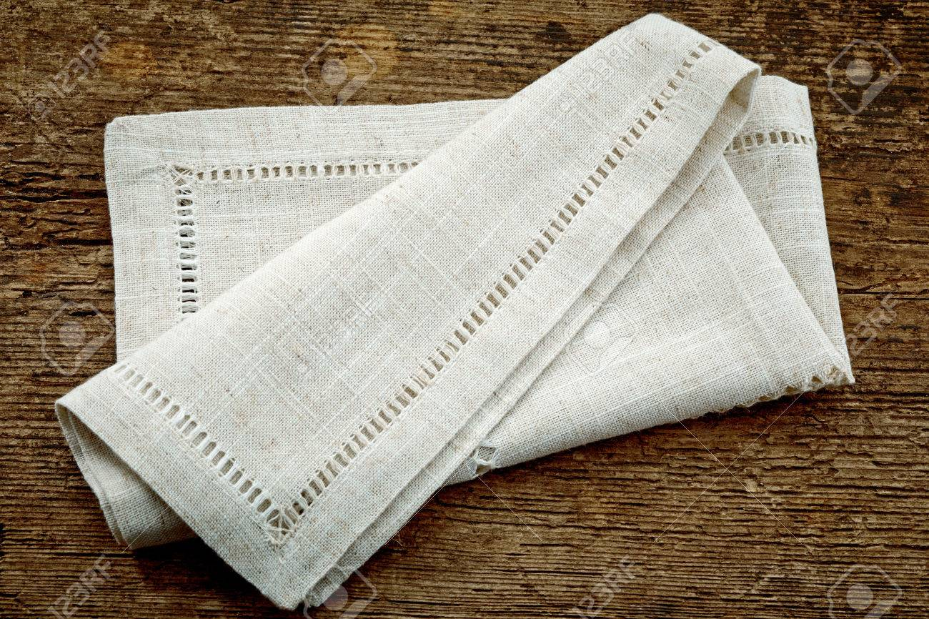Folded Linen Napkin On Old Wooden Table Stock Photo Picture And Royalty Free Image Image 32937639