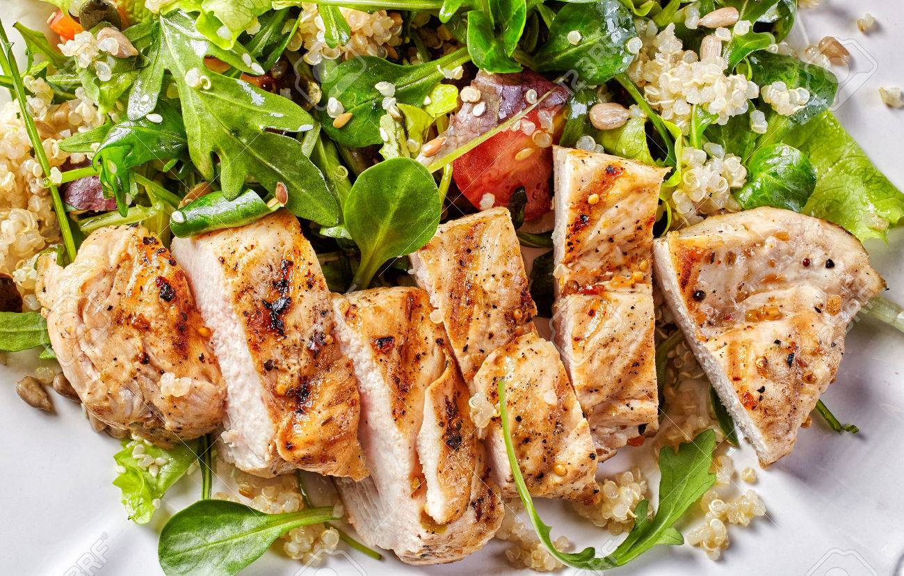 Quinoa and vegetable salad with grilled chicken fillet, top view - 50860913