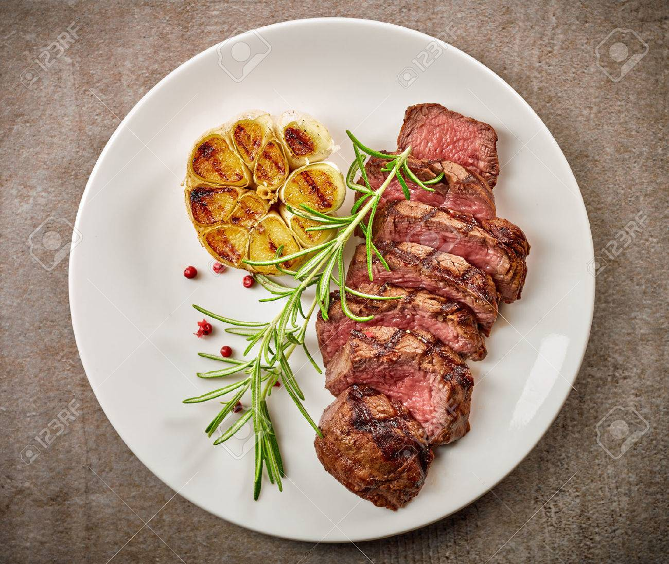 Grilled Sliced Steak And Rosemary On White Plate Top View Stock Photo Picture And Royalty Free Image Image 58394245
