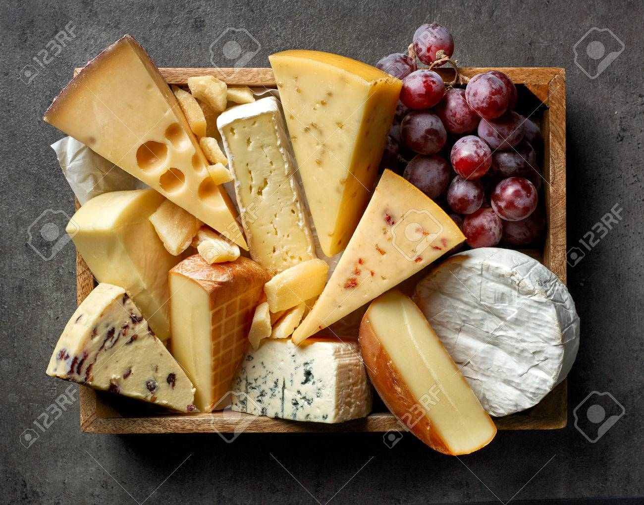 Various Types Of Cheese On Dark Gray Kitchen Table Top View Stock