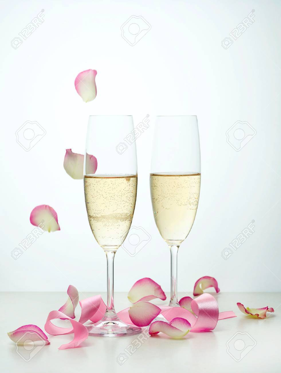 Image result for champagne and pink rose petals