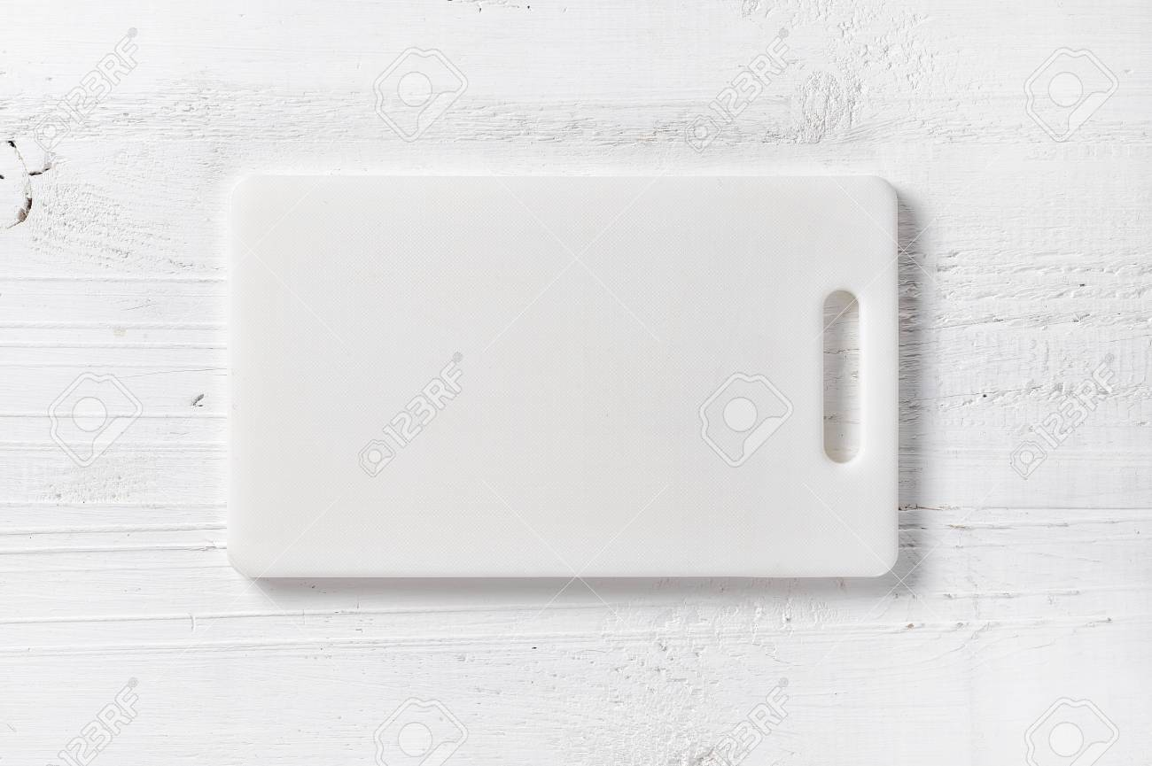 white plastic cutting board on table, top view