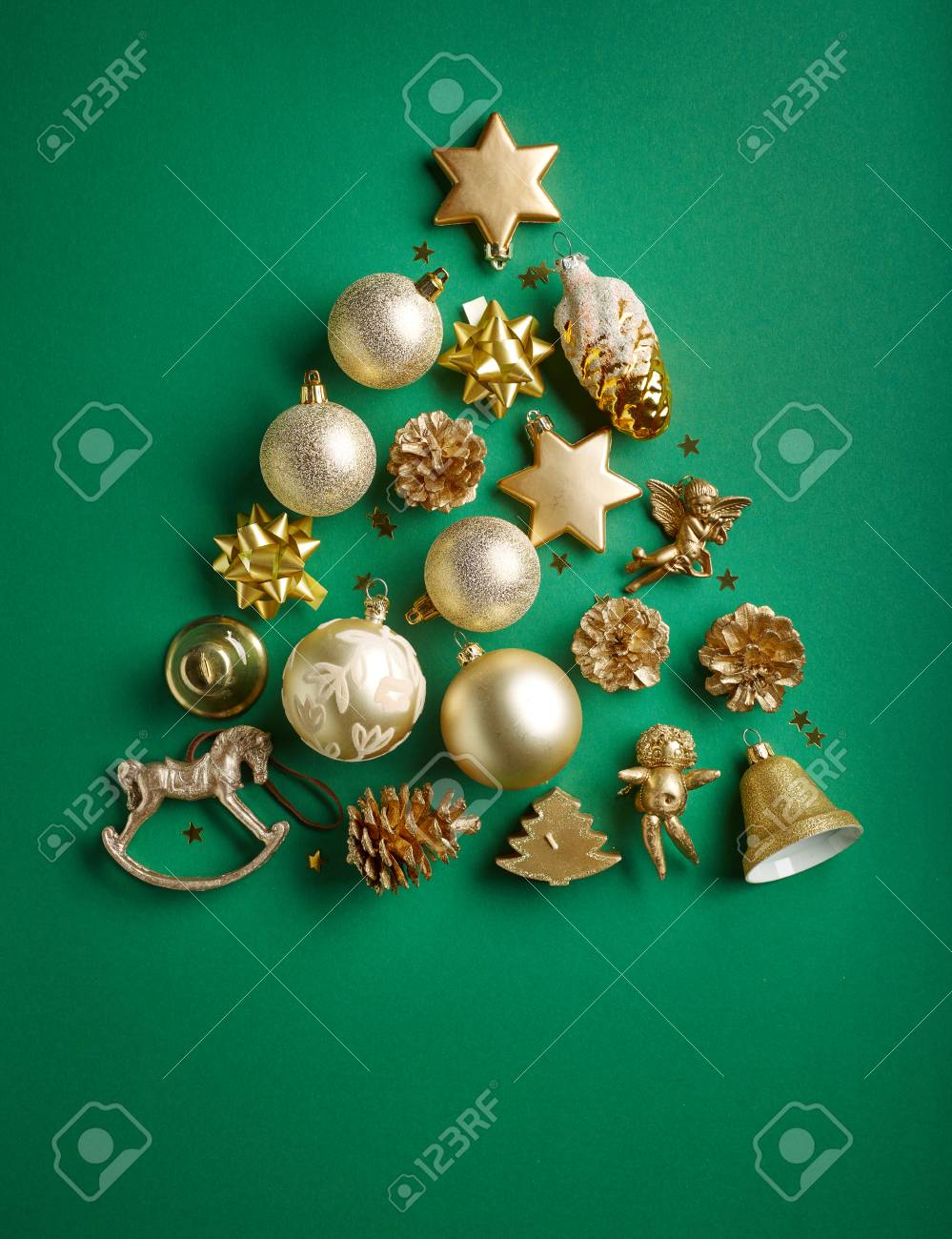 Christmas Tree Of Gold Color Decorations On Green Paper Background ...