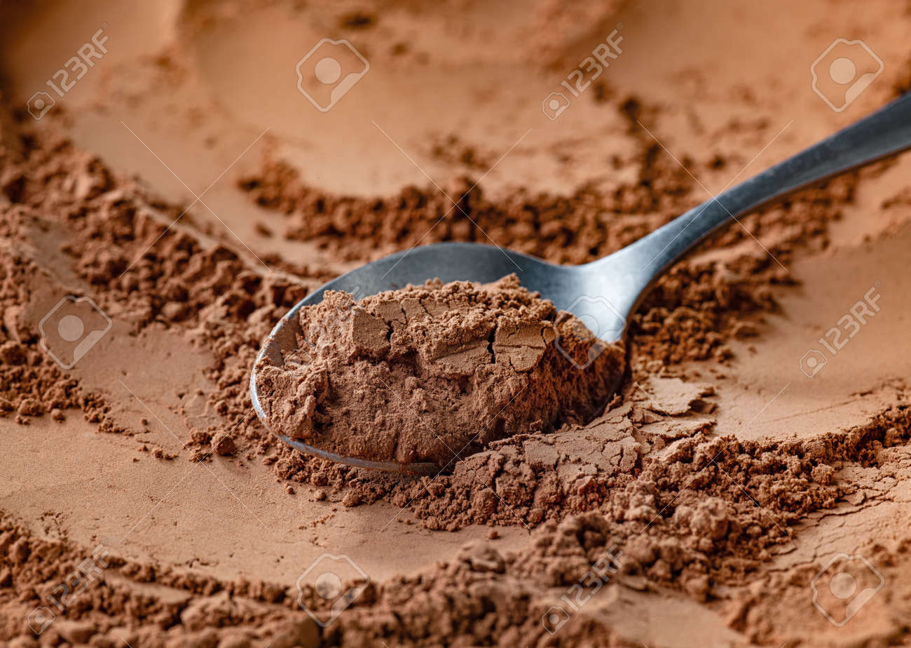 spoon of fine cocoa powder - 158500896
