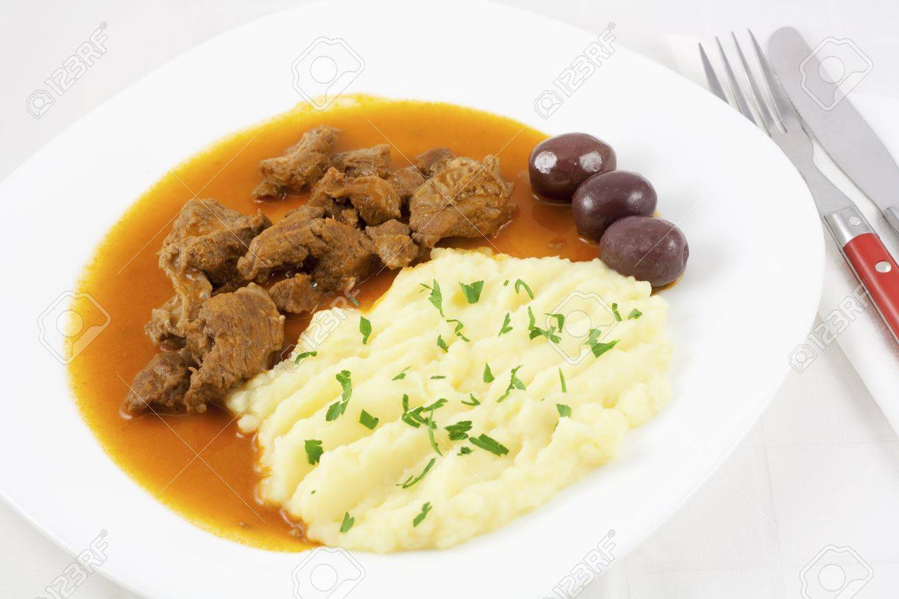 Beef Goulash With Mashed Potato Spiced With Parsley And Three Brown Olives Stock Photo